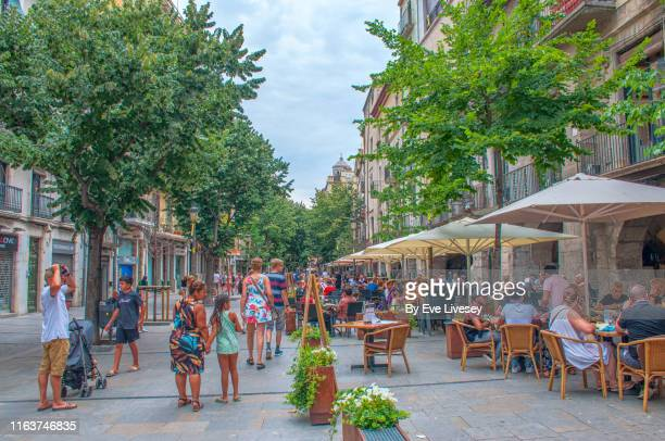 tourists in the rambla de la libertat - gerona city stock pictures, royalty-free photos & images