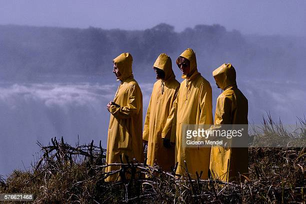 Tourists in Waterproof Jackets at Victoria Falls