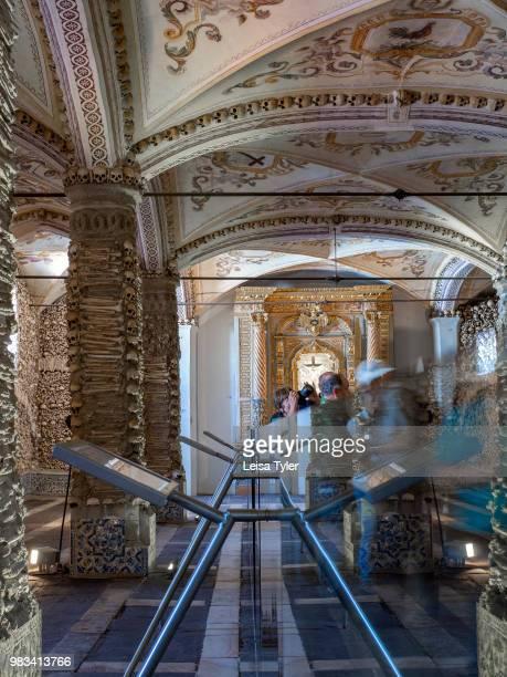 OSSOS EVORA ALENTEJO PORTUGAL Tourists inside the Capela dos Ossos a 16th century chapel built of human bones by a Franciscan monk in Evora Portugal...