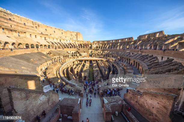 tourists inside the colosseum , rome - italy - colosseum stock pictures, royalty-free photos & images