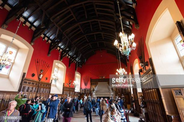 tourists inside the great hall in edinburgh castle - edinburgh castle stock pictures, royalty-free photos & images
