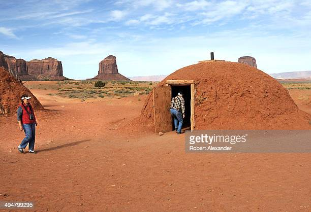 Tourists inspect a traditional Navajo home or hogan during a tour of Monument Valley Navajo Tribal Park in southeastern Utah Monument Valley a...