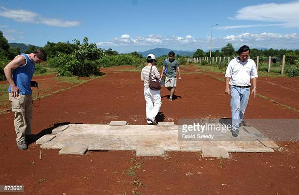 Tourists inspect the only remnants of the metal runway June 26 2002 at the Khe Sanh Combat base in the former Demilitarized Zone in central Vietnam...