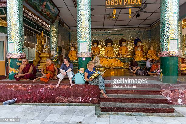 tourists interacting with monks - merten snijders stock pictures, royalty-free photos & images