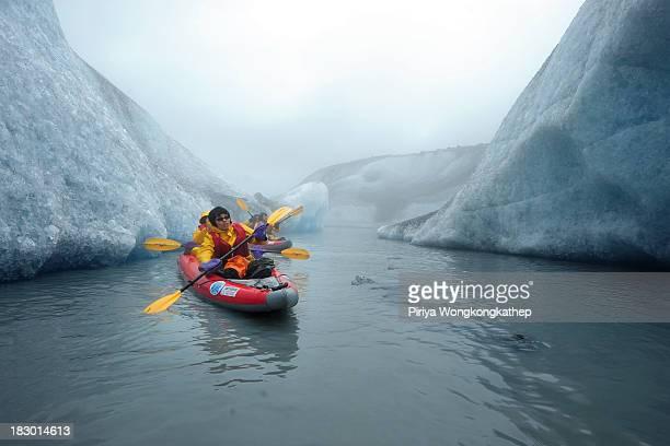 Tourists kayaked between large icebergs from Valdez Glacier in Alaska