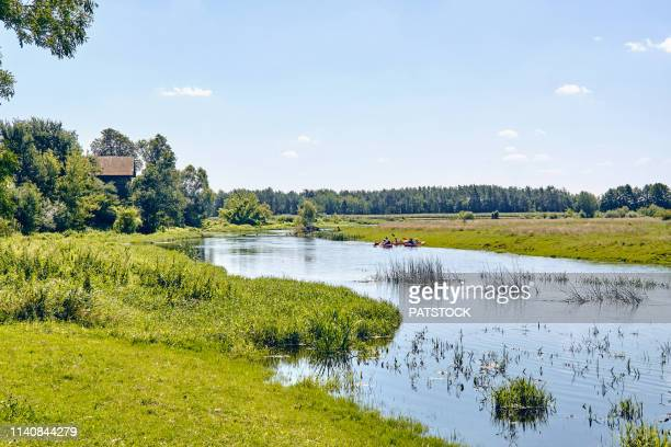 tourists kayaking on wkra river during sunny weekend - mazowieckie stock pictures, royalty-free photos & images
