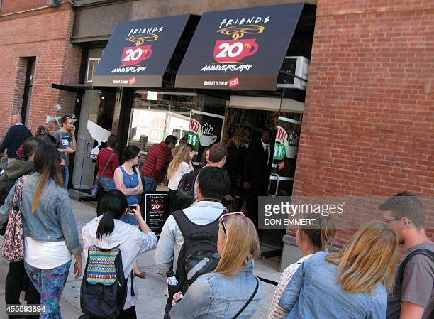 Tourists line up outside a temporary pop up reproduction of the Central Perk coffee shop a center piece set of the television situation comedy...
