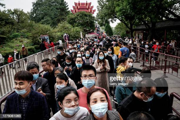 Tourists line up to go up in Yellow Crane Tower on October 7, 2020 in Wuhan, Hubei province, China. China is celebrating its national day from...