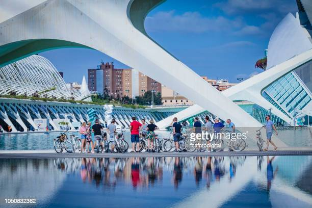 Tourists listen to guide at the City of Arts and Sciences in Valencia, Spain