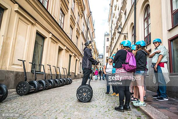 Tourists listening instructions how to use Segway, Stockholm