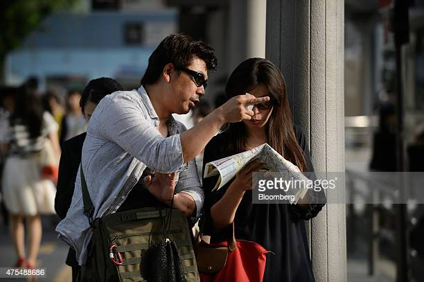 Tourists look at a map in Kyoto Japan on Wednesday May 27 2015 Spending by visitors to Japan jumped to the highest level in at least 20 years adding...