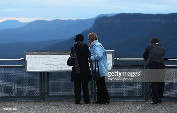 Tourists look at a map of the Blue Mountains from Echo Point on July 15 2009 in Katoomba Australia Missing backpacker Jamie Neale was found earlier...