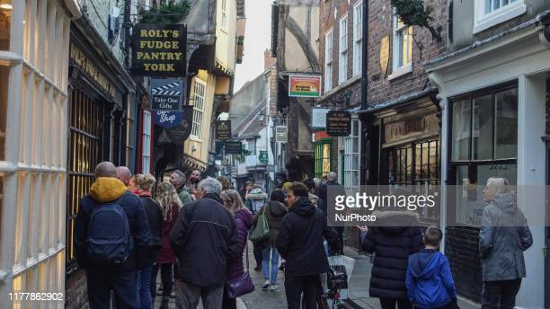 Tourists look at a showcase at the city center of York England on 23 June 2019