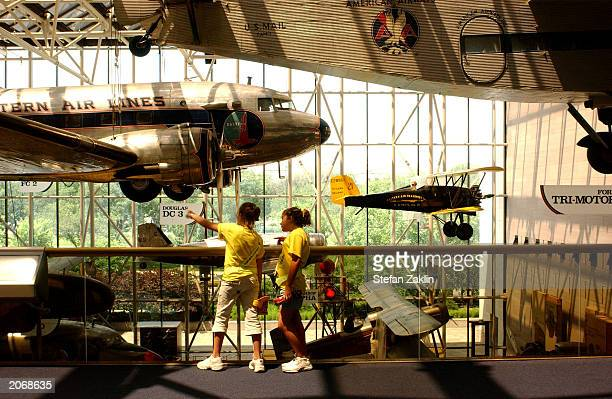 Tourists look at an early commercial airplane at the Smithsonian National Air and Space Museum June 9, 2003 in Washington, DC.