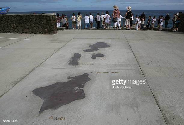 Tourists look at the Halona Blowhole from a vista point October 22 2008 in Honolulu Hawaii Democratic presidential candidate Barack Obama has...