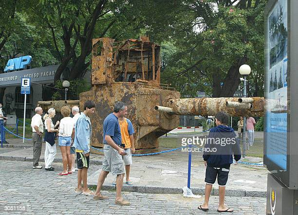 Tourists look at the remains of the rangefinder of the German pocket battleship Admiral Graf Spee 07 March 2004 installed near the entrance gate to...