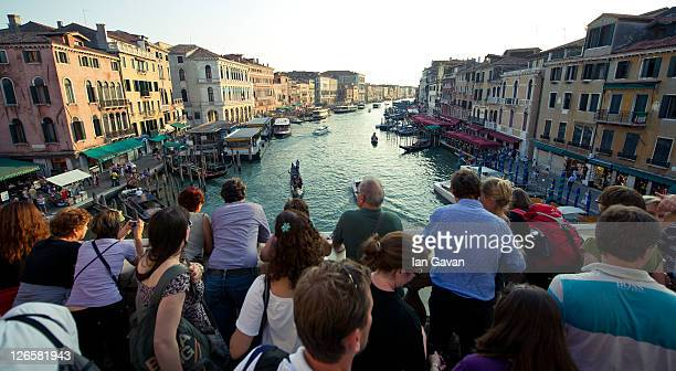Tourists look at the view across the Grand Canal from the Rialto bridge on September 9, 2011 in Venice, Italy.