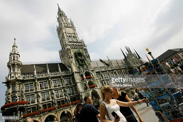 Tourists look for postcards at the Marienplatz on August 20 2005 in Munich Germany Munich is one of the host cities that will be used to stage the...