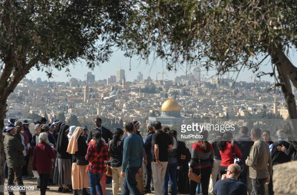 Tourists look from the Mount of Olives at the panoramic view of the Old City of Jerusalem with its Dome of the Rock mosque in the centre. On...