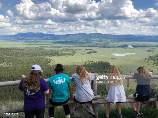 Tourists look out at Signal Mountain in the Grand Teton National Park Wyoming on June 10 2019