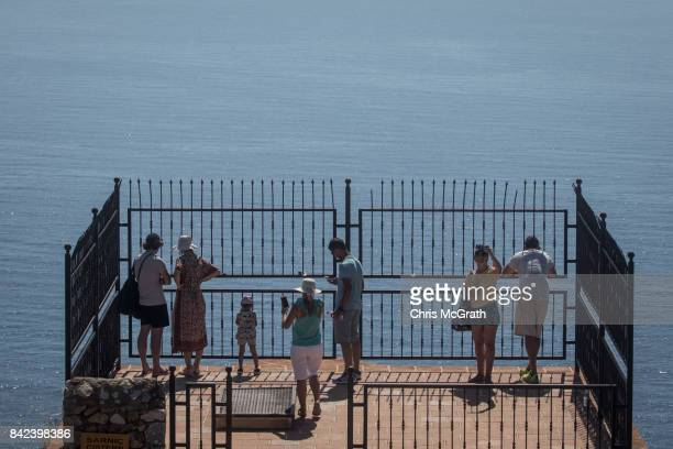Tourists look out from the Alanya Castle on September 3 2017 in Alanya Turkey Turkey's tourism industry spiraled into crisis in 2016 after a year of...