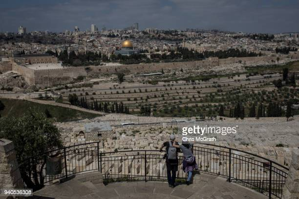 Tourists look out over the Al-Aqsa Mosque and the Old City on March 31, 2018 in Jerusalem, Israel. Thousands of tourists and pilgrims have descended...