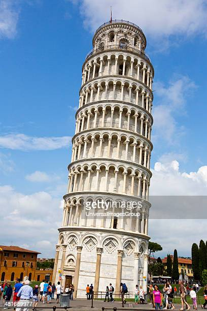 Tourists looking at a tower Leaning Tower Of Pisa Piazza Dei Miracoli Pisa Tuscany Italy