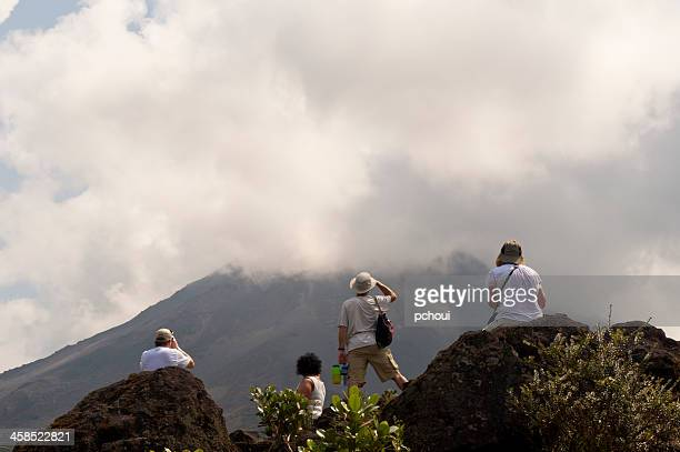 Tourists looking at active Arenal Volcano in Costa Rica