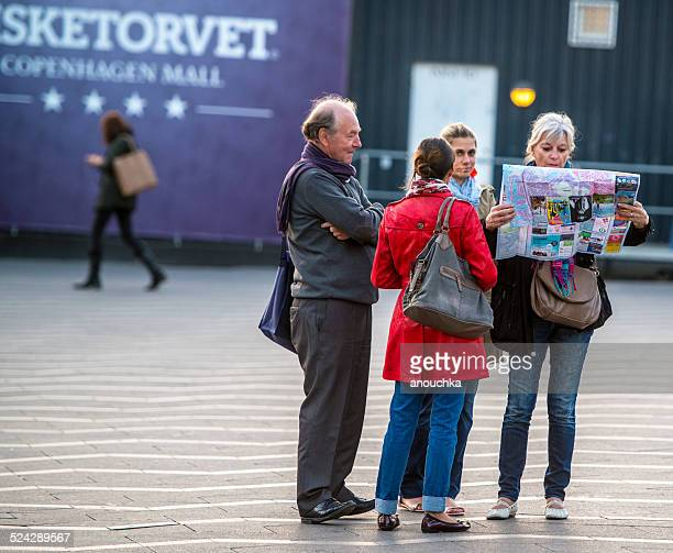 Tourists looking at city map in Copenhagen