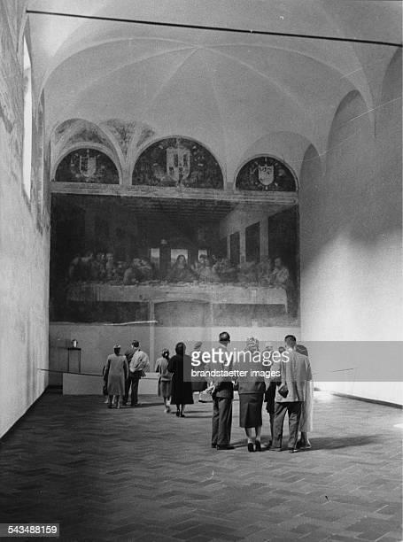 Tourists looking at Leonardo da Vinvis last Supper in the Santa Maria della Grazie in Milan About 1970 Photograph