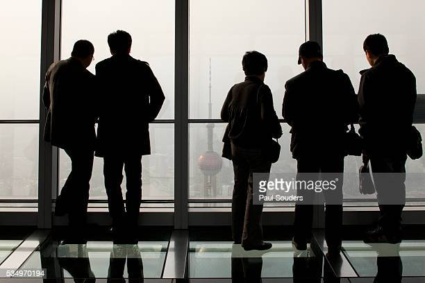 Tourists looking at view from observation deck