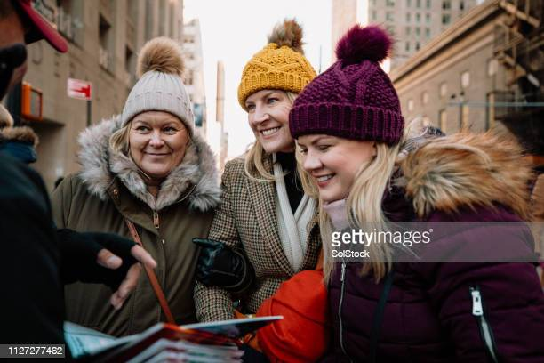 tourists looking for directions - sayings stock pictures, royalty-free photos & images