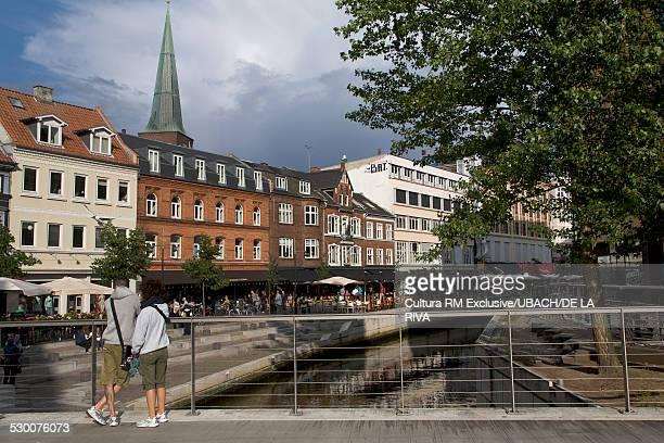 Tourists looking over bridge to Arrhus river, Aarhus, Denmark