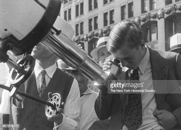 Tourists looking through a telescope 1929