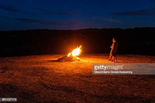 Tourists looks the volcano's flame coming out from the subsoil during the night on August 14 2017 in Forli Italy The volcano of Monte Busca is the...
