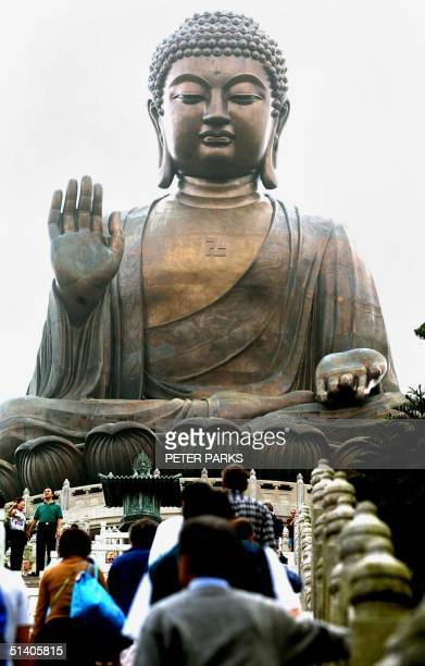 Tourists make their way up to the largest bronze Buddah in the world on Lantau island Hong Kong, 22 October 2002. The Big Buddah and the Po Lin...
