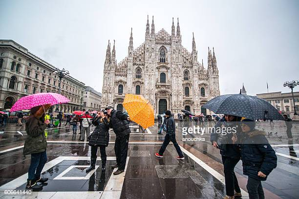 Tourists making selfie under snow in Milan, Italy