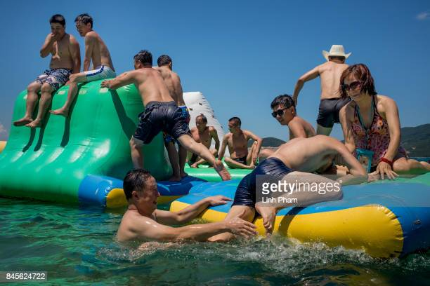 Tourists mostly Chinese play with the inflatable toys by the beach of Hon Tam Resort on September 10 2017 in Nha Trang Vietnam With a total of 27...