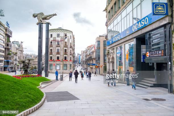 Tourists near El Sireno monument on Praza Porta do Sol in Vigo, Spain.