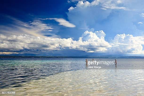 tourists near rabaul, papua new guinea - jake warga stock photos and pictures