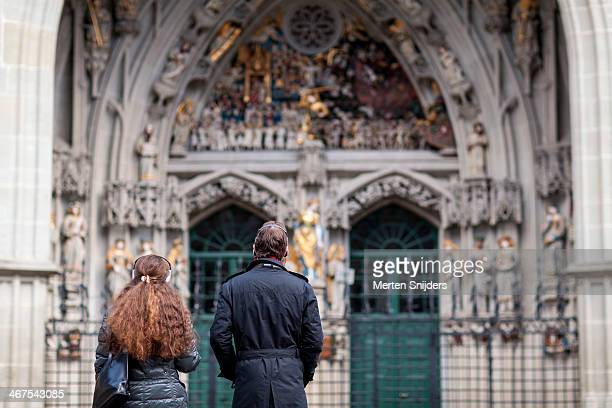 Tourists observing church ornaments