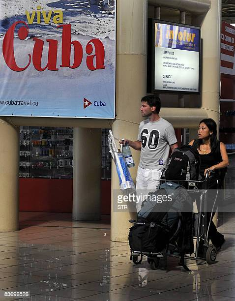 Tourists of an Air Canada flight from Toronto arrive at Jose Marti International Airport in Havana on November 14 2008 helping Cuba surpass the two...
