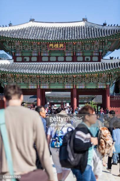 Tourists of Gyeongbokgung Palace in Seoul Korea.