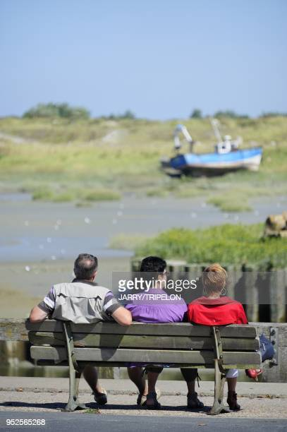 Tourists on a bench harbour of Le Crotoy Baie de Somme and Cote d'Opale area Somme department Picardie region France