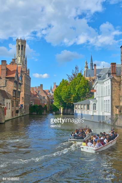 Tourists on a boat in Bruges