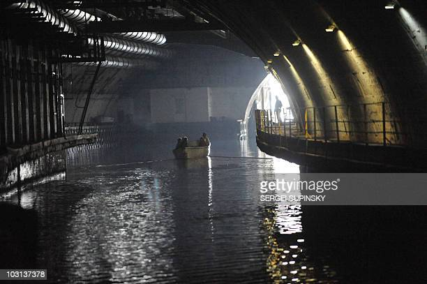 Tourists on a boat visit on May 8 2010 the former Soviet underground submarine base of Balaklava in southern Ukraine near Sevastopol Although the...