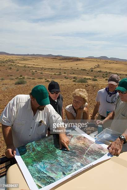 Tourists on a Desert Safari Looking at a Map