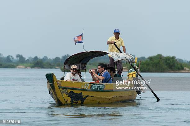 Tourists on a Dolphin spotting eco tour on the Mekong River near Kratie