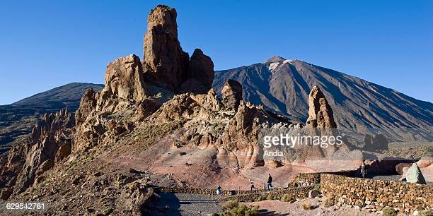 Tourists on a road in front of rocks on the Pico del Teide volcano Teide National Park Canaries Tenerife Spain