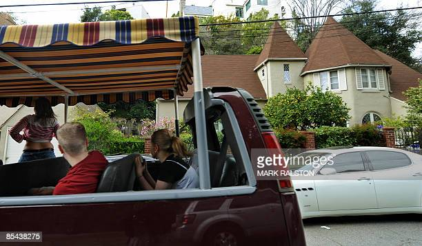 Tourists on a tour of stars houses pass by the home and sports car of Lindsay Lohan and friend Samantha Ronson in the Hollywood Hills area of Los...